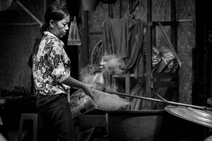 Photo of a woman cooking in Phnom Penh by Alex Leonard